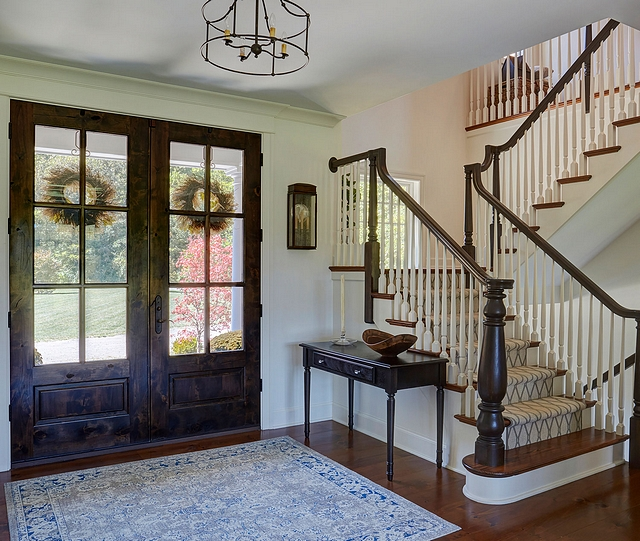 Wood front door The front doors open to a traditional foyer The front door is a pair of Master Crafted Door with 3-point locking mechanism, divided lites, and raised panel at lower part of the doors in knotty alder #wooddoor #frontdoor #traditionalfoyer #foyer #knottyalder #door