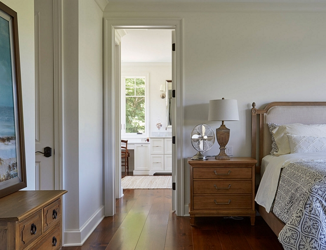 The master bedroom and bathroom features the same wide plank pine flooring #bedroom #bathroom #hardwoodflooring