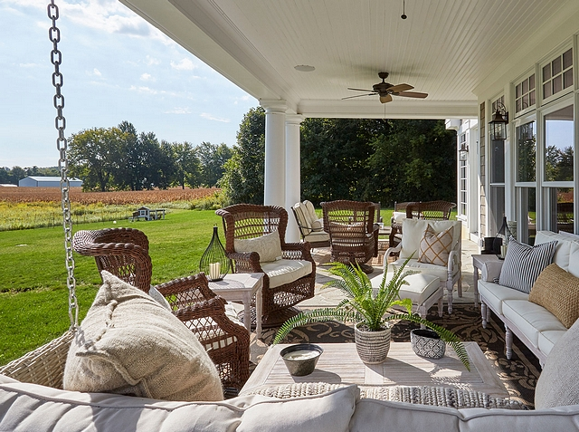 Gorgeous back porch with swing and plenty of comfortable seating #backporch #porch #porchswing