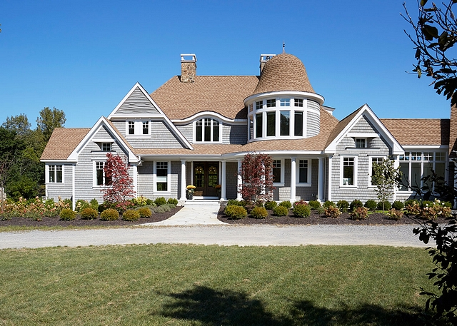 Grey shingle home This Nantucket shingle style home features white cedar shake siding stained gray and an asphalt shingle roof #greyshinglehome #greyhome #shinglehome