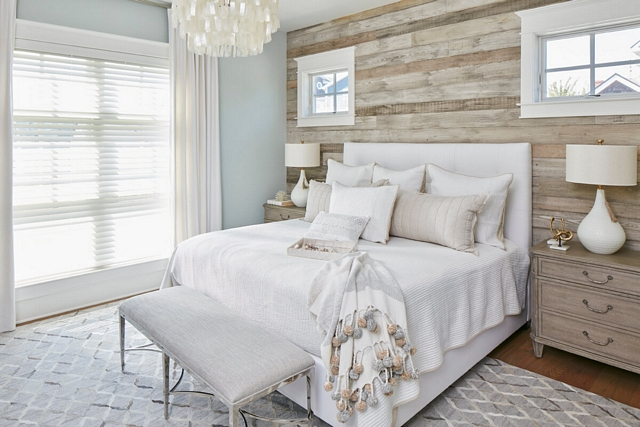 The master bedroom features a barn wood shiplap accent wall #shiplap #barnwood #barnwoodshiplap