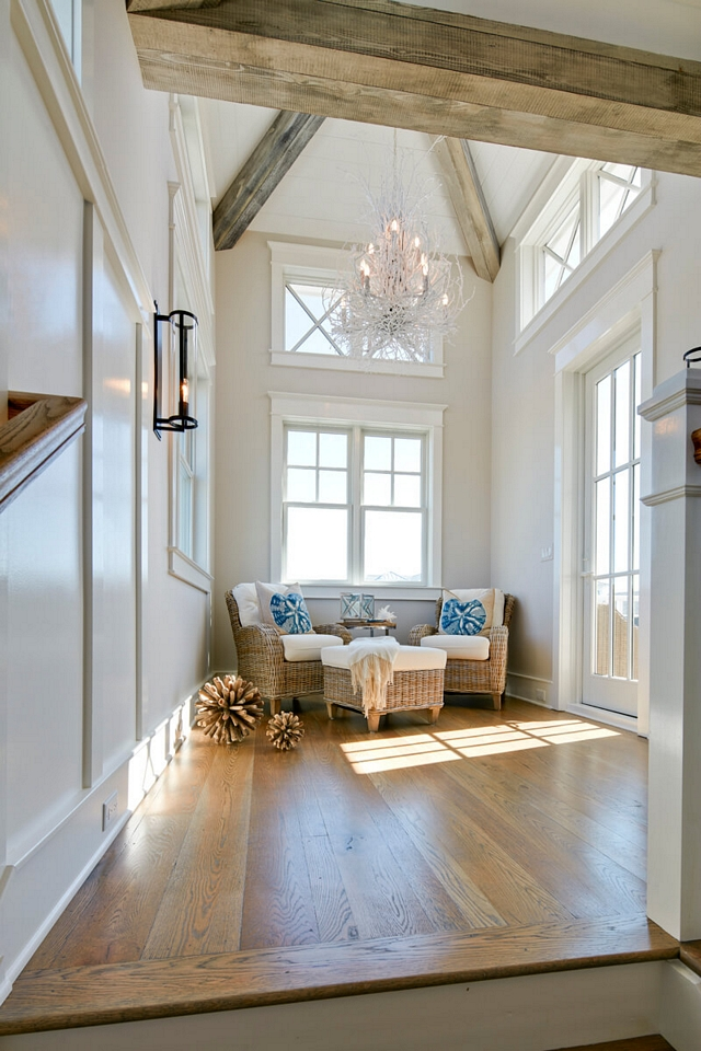 Upper landing featuring exposed beams and French doors leading to a private balcony Coastal Upper landing Coastal Homes Coastal Interiors Coastal Beach house #Upperlanding #exposedbeams #Frenchdoors #Coastal #Upperlanding #CoastalHomes #CoastalInteriors #CoastalBeachhouse #coastal #beachhouse