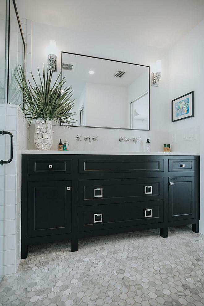 Black bathroom vanity paint color Bathroom also features a custom vanity by Crystal Cabinet Works in a Black Matte Finish. Countertop is Caesarstone Calacatta Nuvo Black bathroom vanity Black bathroom vanity Black bathroom vanity #Blackbathroomvanity