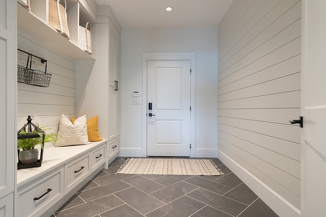 Farmhouse Mudroom Shiplap Dark large-scale herringbone floors with light grout distract from the dirt that is ever-present in our mud room #mudroom #shiplap #mudroomtile