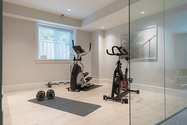 "Home Gym The first question people ask when they see this room is, ""do you actually use your gym?"" Why yes, yes we do! We added 3 large glass panels, so this room doesn't feel closed off from the rest of the basement #homegym"