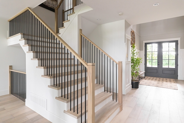 "Wood Staircase Treads Instead of carpet I opted for hardwood stairs with white risers. I shifted away from the thick and heavy spindles and selected thin rails and posts. These white oak posts are only 4"" wide #staircasetreads #staircase #stairwell #treads"