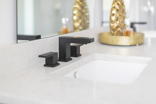 Black matte bathroom faucet These bold black vanity faucets tie in nicely with the black hardware and tub #bathromfaucet #blackmattefaucet