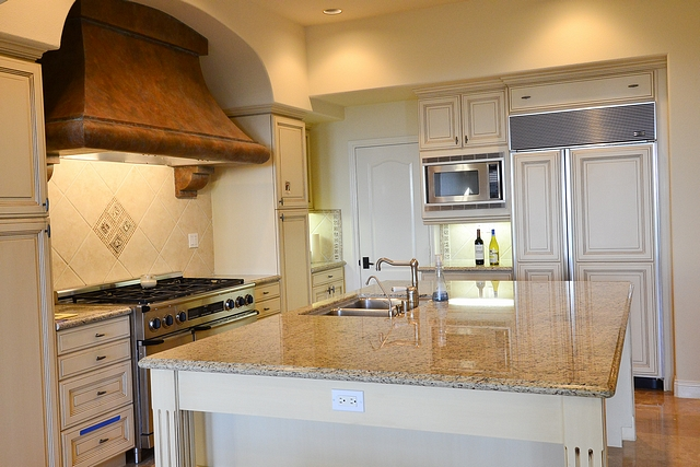 "Before and After Kitchen Design The older kitchen felt dark and the ""old Mediterranean"" style had a heavy feel to it"