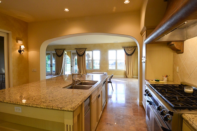Kitchen Before and After Reno An archway used to separate the kitchen from the dining area