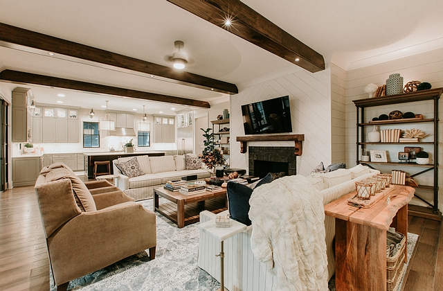 Living room featuring fireplace wall with shiplap and chevron wall paneling #shiplap #wallpaneling #cheronshiplap #chevronpaneling #livingoom #fireplace