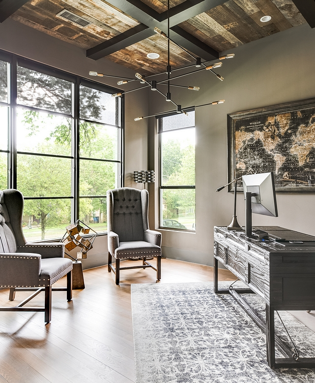 Gauntlet Gray by Sherwin-Williams This masculine home office features black steel windows and barn wood ceiling with boxed beams. Wall paint color is Gauntlet Gray by Sherwin-Williams Gauntlet Gray by Sherwin-Williams Gauntlet Gray by Sherwin-Williams #GauntletGraybySherwinWilliams