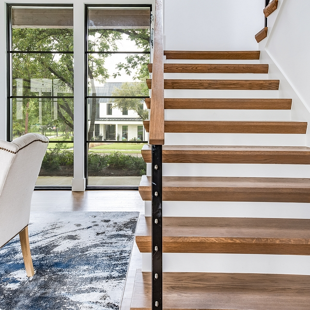 Modern farmhouse staircase photos Modern farmhouse staircase featuring wood treads and metal and cable railing #Modernfarmhousestaircase #woodtreadstaircase #staircase #metalandcablerailing #cablerailing #cablerailingstaircase