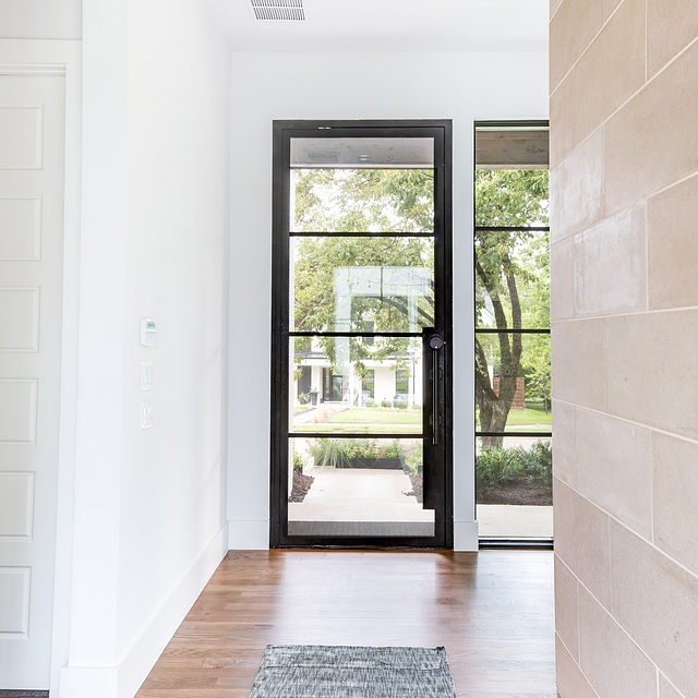 Steel and glass front door The front door is made out of steel and glass and it was custom-made for this home Steel and glass front door Black Steel and glass front door #Steelandglassdoor #frontdoor
