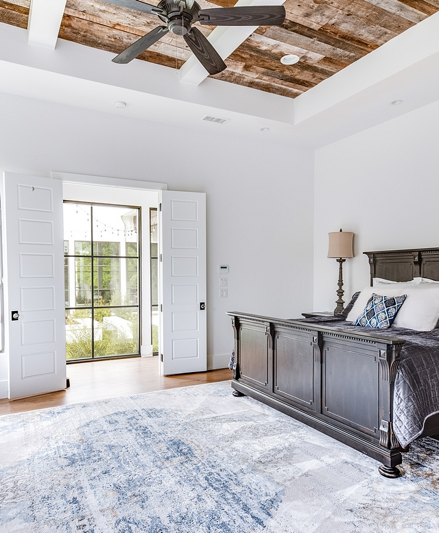 The master bedroom was kept simple to give emphases to the architectural details such as the reclaimed barnwood ceiling #barnwood #bedroom #masterbedroom