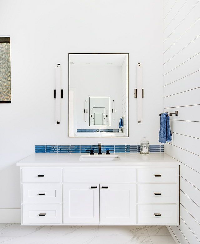 Modern Farmhouse Bathroom Featuring custom floating vanities facing each other, this master bathroom has a fresh design and many inspiring design ideas #bathroom #modernfarmhousebathroom