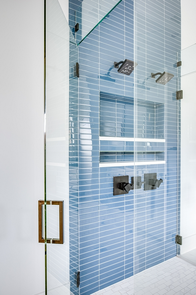 Shower with blue and white tile Blue glass tile #shower #bluglasstile #showertile
