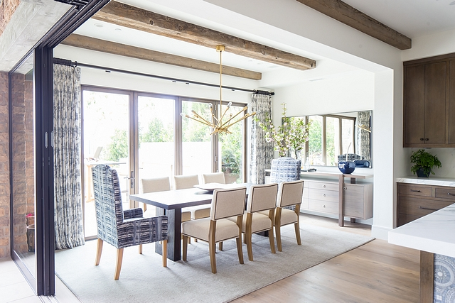Dining Room with an outdoor feeling The dining room was divided to create a larger outdoor area and it now features a pair of retractable patio doors #Diningroom #outdoor #indoor #retractablepatiodoor
