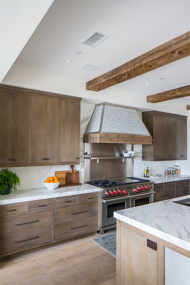 Mediterranean kitchen Modern Mediterranean kitchen with tiled Hood, ceiling beams and Rift Oak cabinets with custom grey stain #Mediterraneankitchen #Mediterraneaninteriors #ModernMediterraneankitchen #tiledhood #ceilingbeams #kitchenbeams #RiftOakcabinets #greystaincabinet
