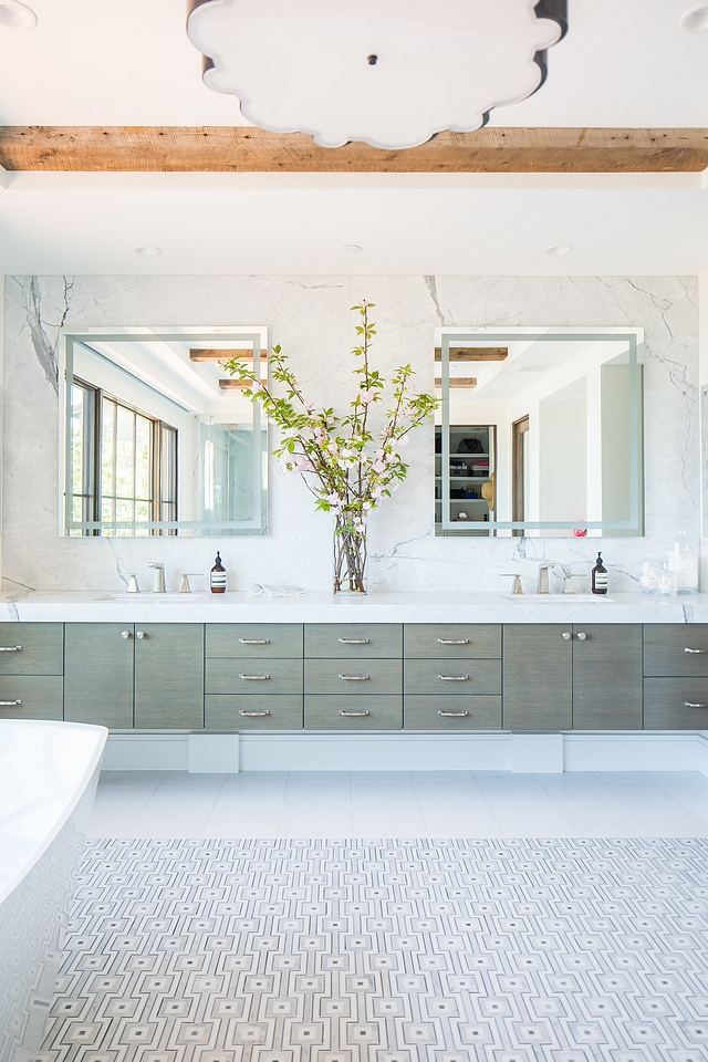 Floating Bathroom Vanity with two sinks Featuring a long floating Rift Oak vanity with greywash finish, a counter-to-ceiling marble slab backsplash and double sinks, this is, by all means, a show-stopper bathroom Floating Bathroom Vanity with two sinks Gray Wood Floating Sink Vanity #FloatingBathroomVanity #bathroomvanity #vanity