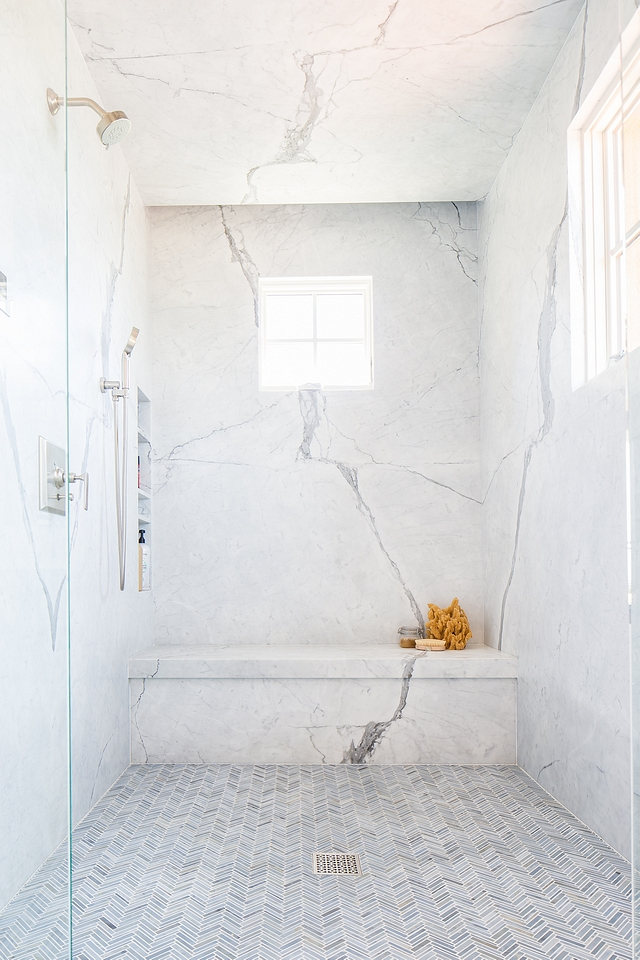 Shower Slab Wall Shower Marble Slab Wall The large walk-in shower features thin marble herringbone floor tiles and stunning Statuario marble slab walls Shower Slab Wall Shower Marble Slab Wall #ShowerSlab #WallShower #MarbleSlabWall #showerMarbleSlabWall #MarbleSlab