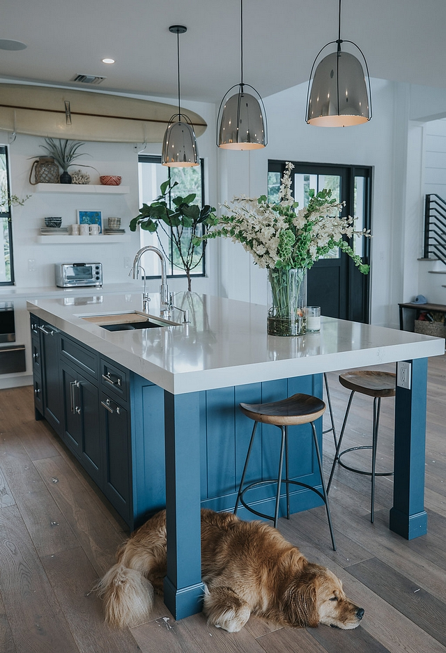 """The table end on the island was a very important aspect to the island's design. The owners wanted a place for their children to do homework The intentional simplicity of the square legs and the 6"""" custom V-groove panel end reflect the simplicity of their lifestyle #kitchenisland #islanlegs #kitchenislanddesign"""