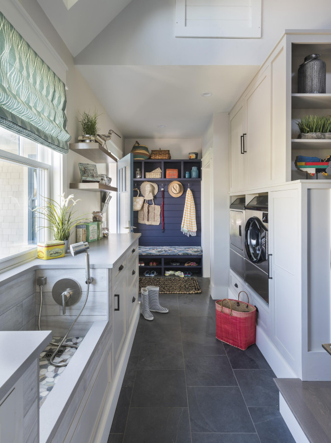 This pet-friendly laundry/mudroom comes with a very practical dog-washing station. The area also doubles as a utility sink for sandy sneakers and swimsuits. Cubbies are painted in Black Flame by Olympic Paint. Also notice that the washer and dryer are elevated on back-saving pedestals