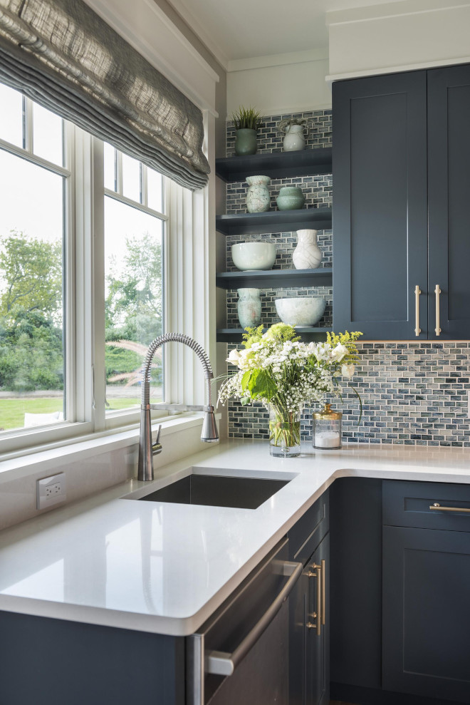 Navy blue kitchen with white quartz countertop