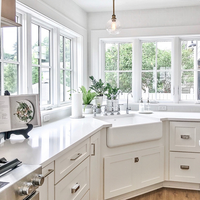 Shaker-style white kitchen cabinet with corner sink.