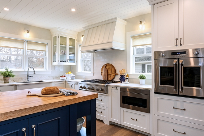 Perimeter cabinetry: Custom frameless cabinetry in a painted maple with a traditional shaker style door