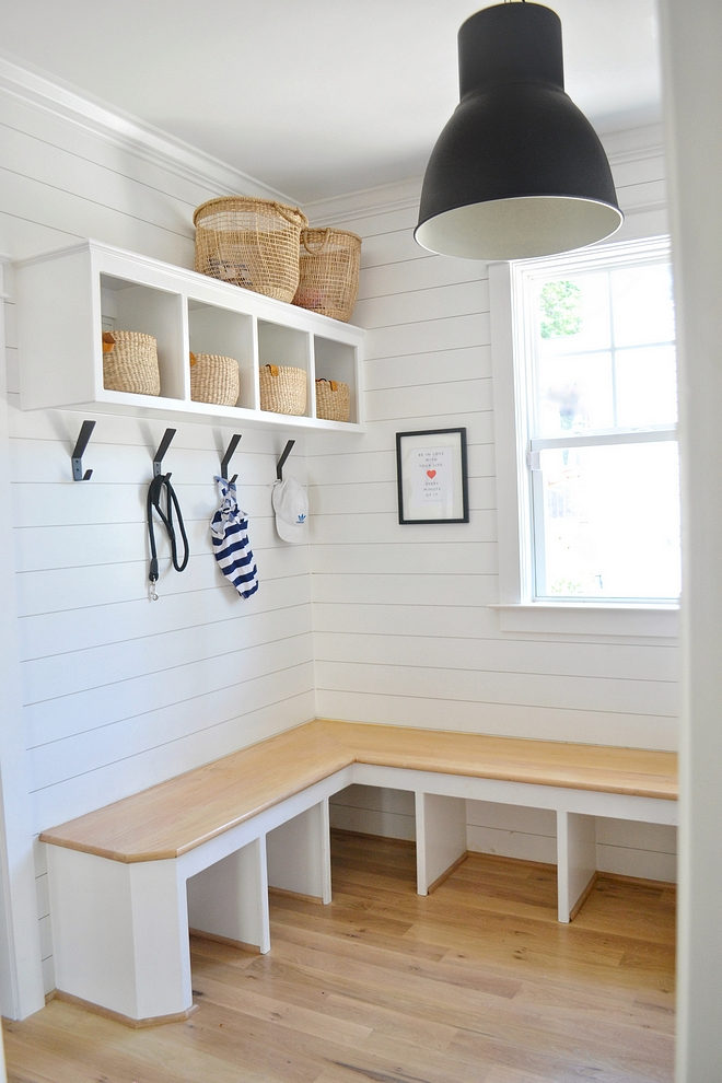 The mudroom features a custom L-shaped bench with Oak seating