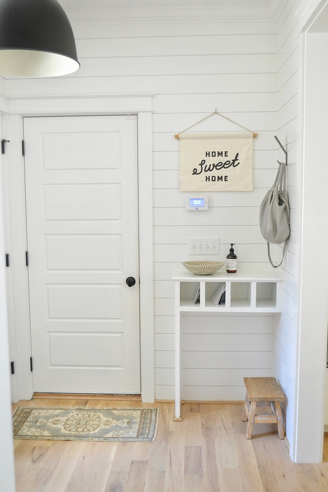 This beautiful mudroom also features a custom drop-zone/desk area