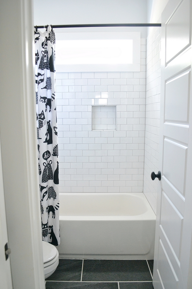 Shower tile is subway tile with gray grout