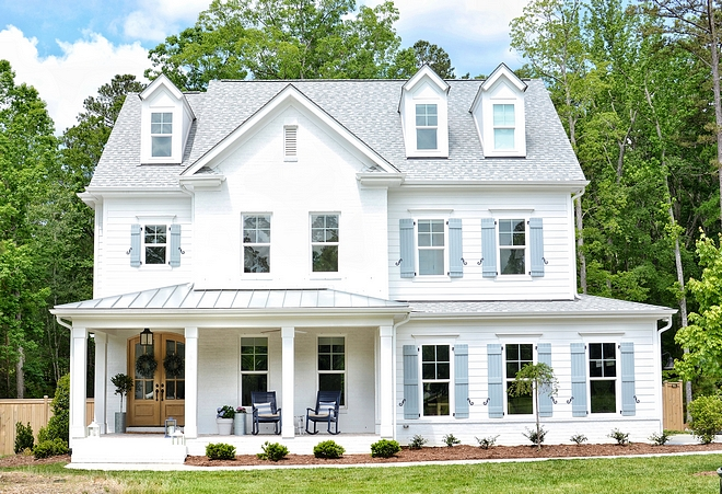 White Brick Home Exterior with Grey Shutters