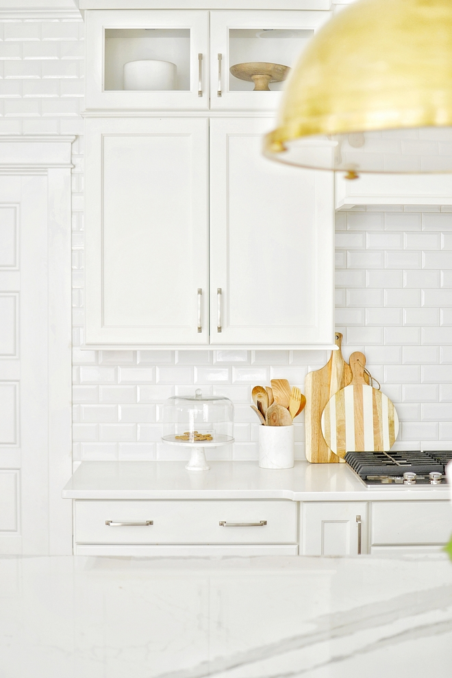 Kitchen backsplash is beveled subway tile