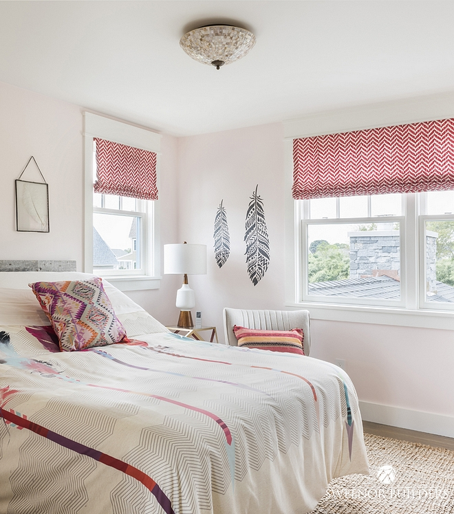 The Bohemian-chic bedding was the inspiration for this girl's bedroom. Wall paint color is Aubergine by Olympic Paint