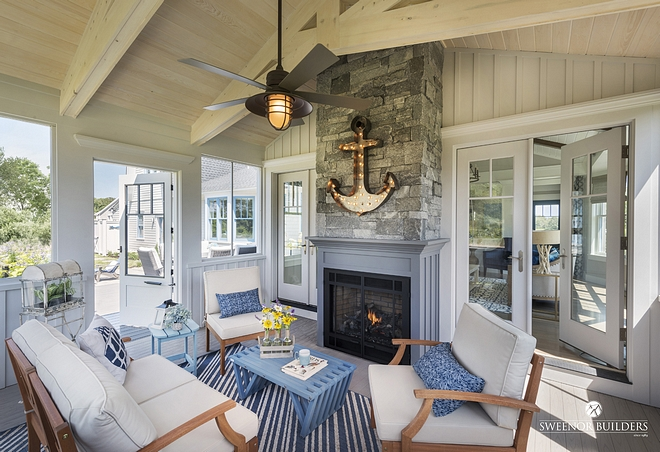 A screened-in porch with fireplace extends the living space of this home