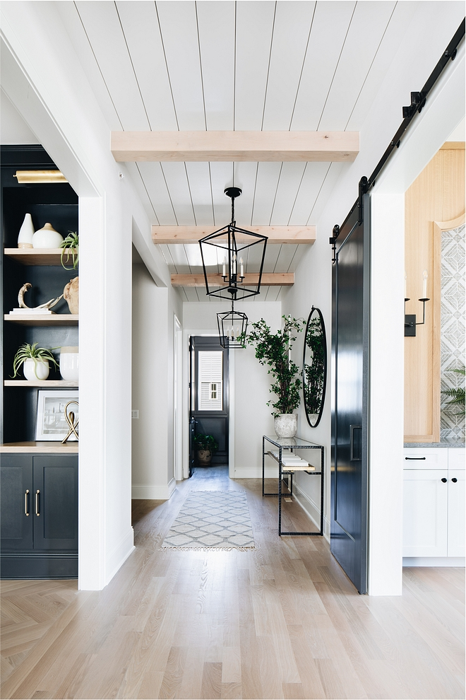 The hallway ceiling features shiplap with Knotty Alder beams