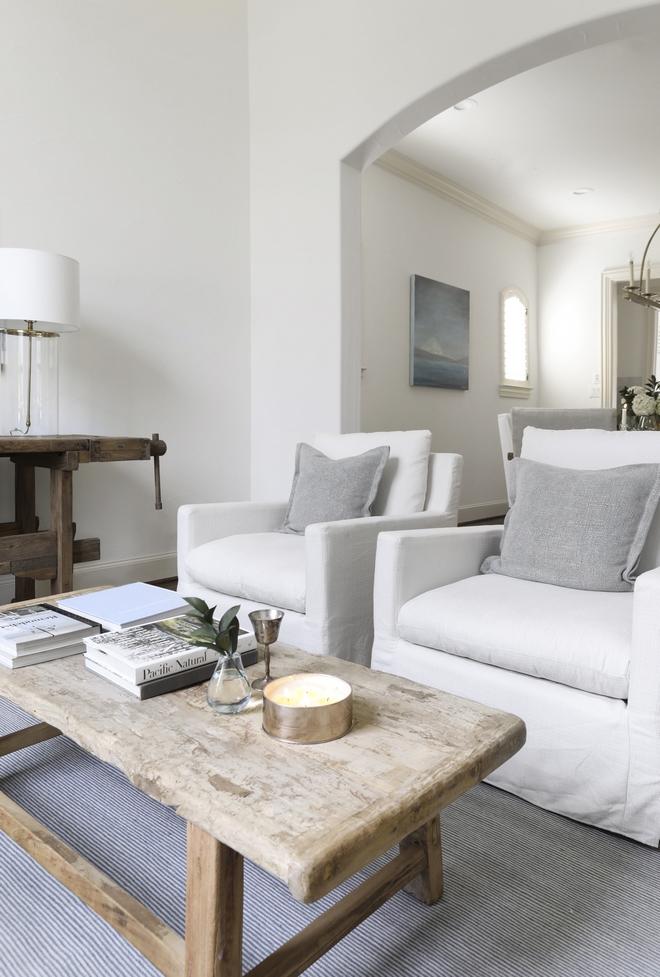 White slipcovered swivel chair