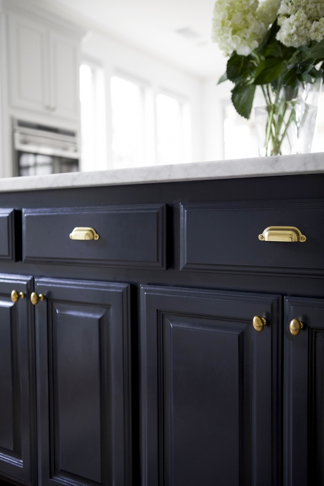 Benjamin Moore Midnight is a deep navy blue paint color that works beautifully on cabinets