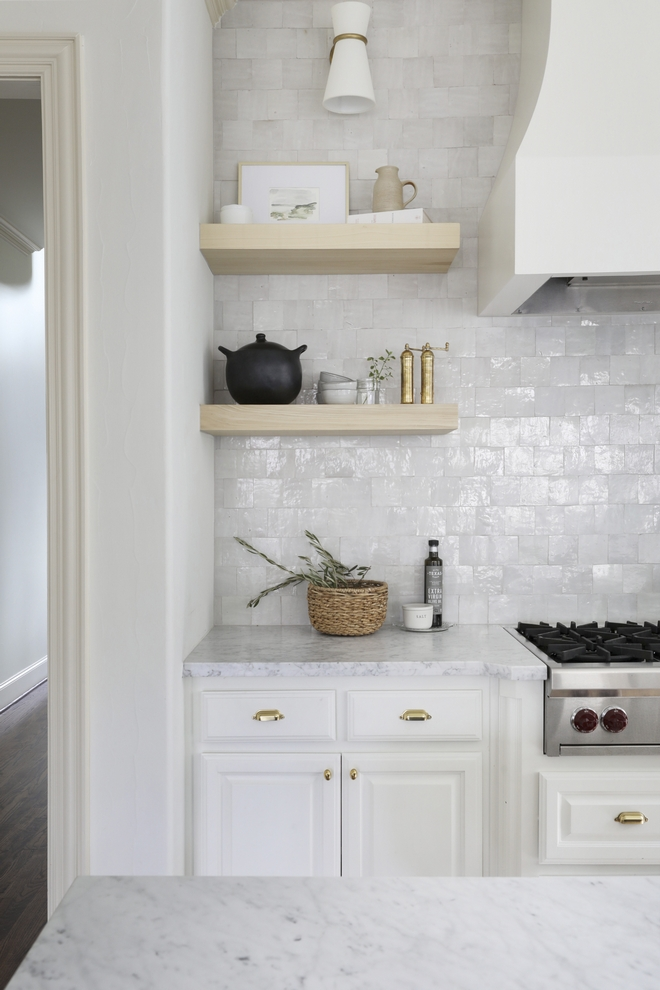 Benjamin Moore Swiss Coffee Kitchen with White Oak Floating Shelves and handmade square tiles