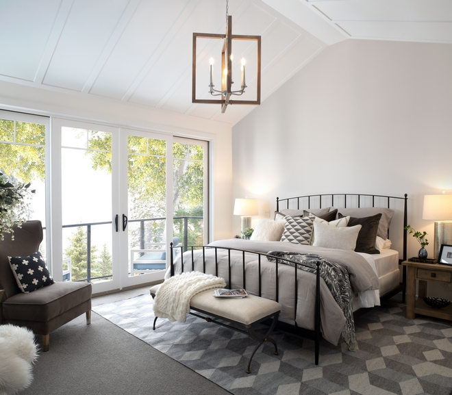 Master Bedroom features vaulted ceilings with custom millwork and a private balcony facing the backyard