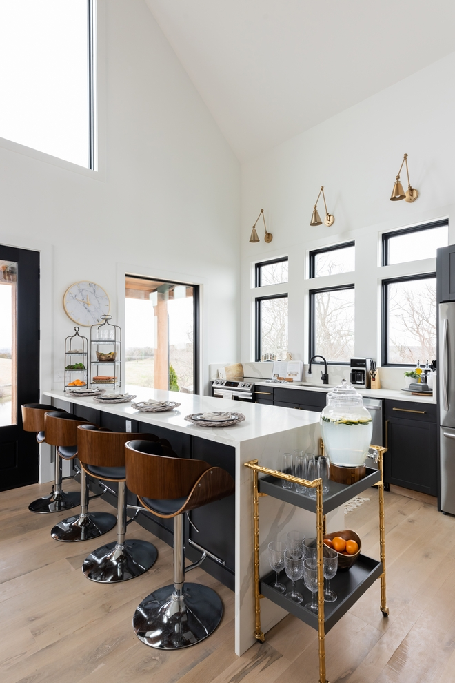 Kitchen Windows allow plenty of natural light into this practical and stylish Kitchen while a large peninsula with a waterfall countertop offers plenty of storage and it is the perfect place to eat your casual meals