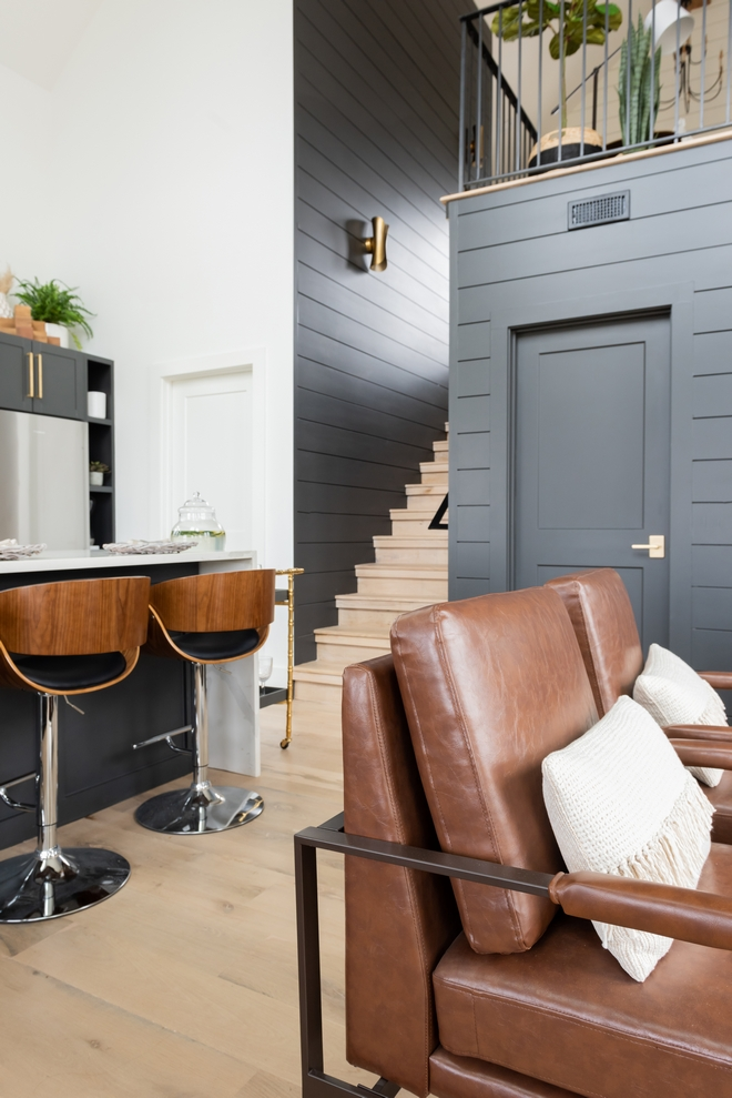 Modern Farmhouse Staircase features White Oak treads/risers and double nickel gap spacing in Sherwin Williams Iron Ore Modern Farmhouse Staircase