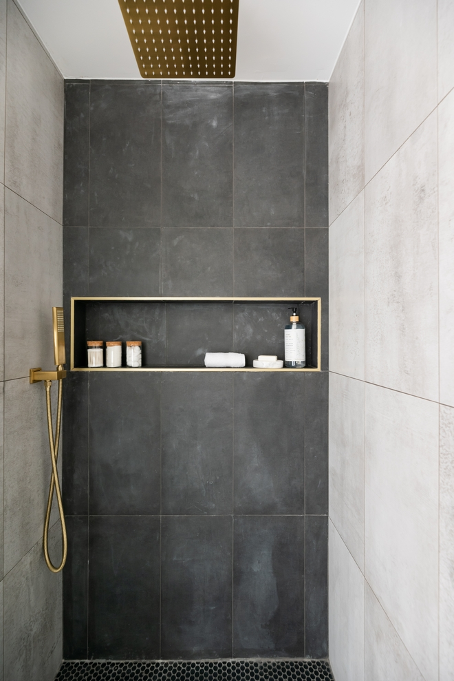 Concrete-looking tiles keep this shower feeling simple organic and low-maintenance