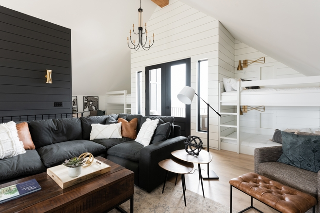 French doors to a private balcony are accentuated with white shilplap and flanked by custom Bunk Beds