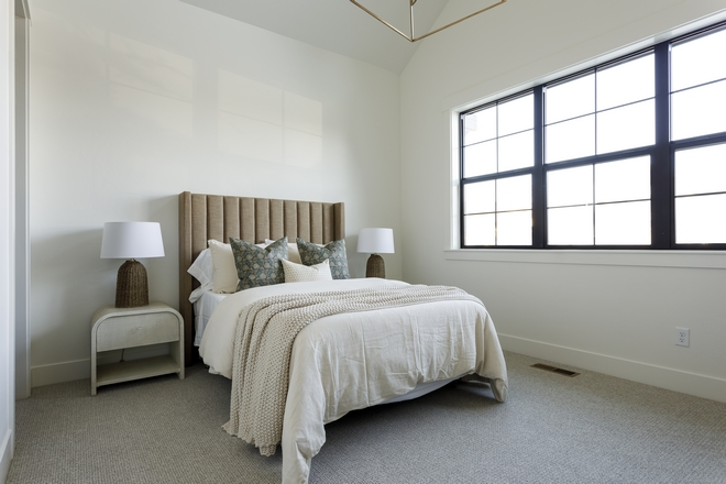 Neutral Bedroom with channeled bed