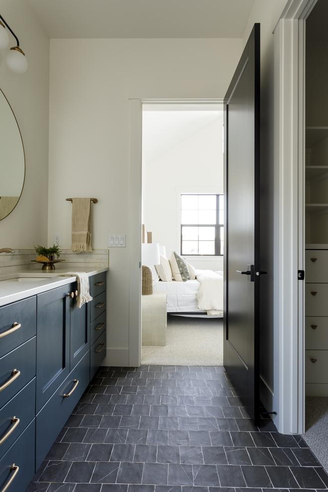 Bathroom Ideas The guest suite bathroom has one of my heart I loved mixing the dark tile floors with a moody cabinet
