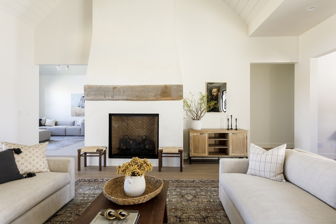 Stucco Fireplace with chunky reclaimed beam mantel