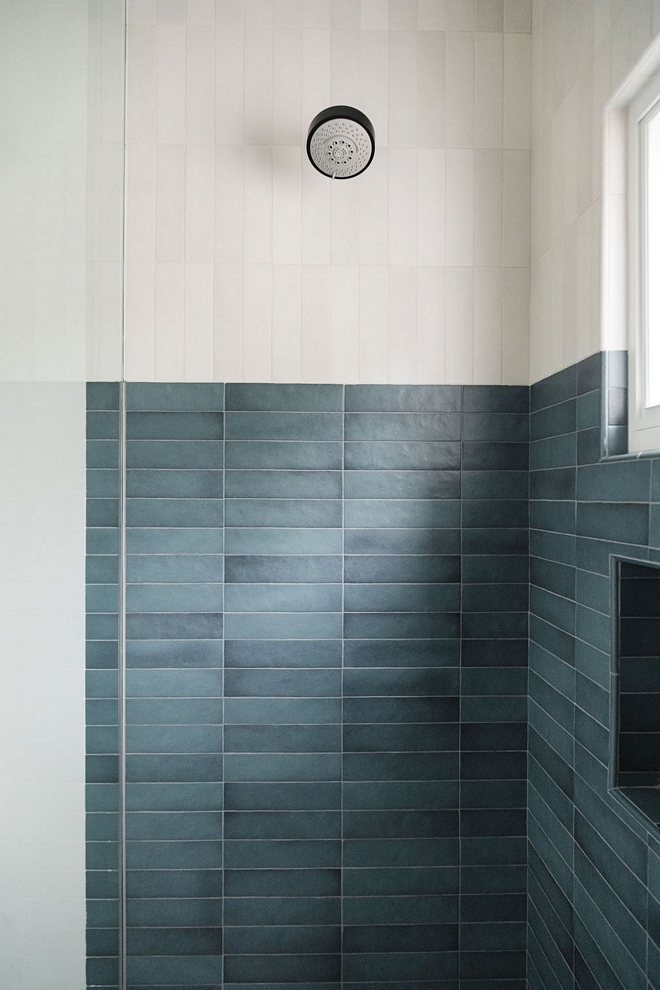 Bathroom features a two-toned shower with vertical and horizontal stacked tiles