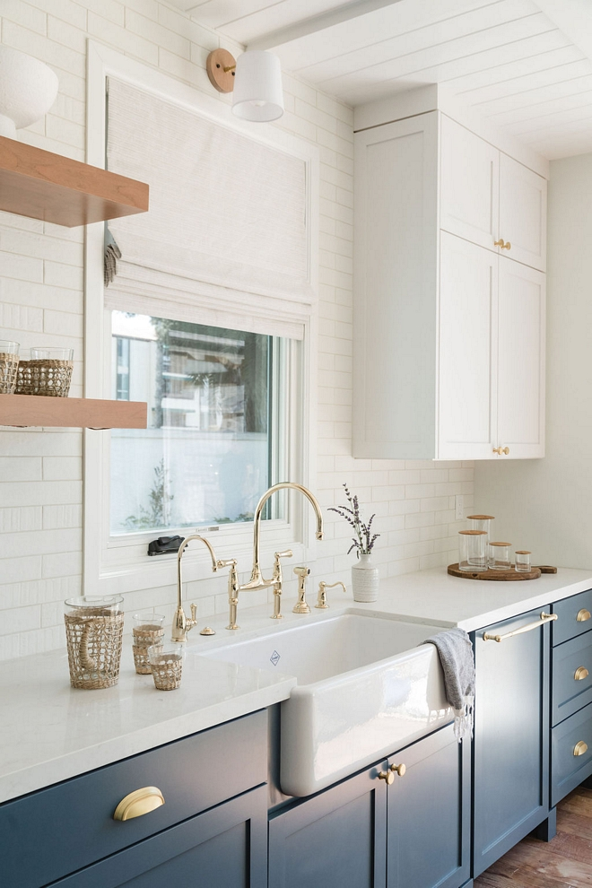 Blue and white two-toned kitchen with Carrara Marble Quartz Countertop